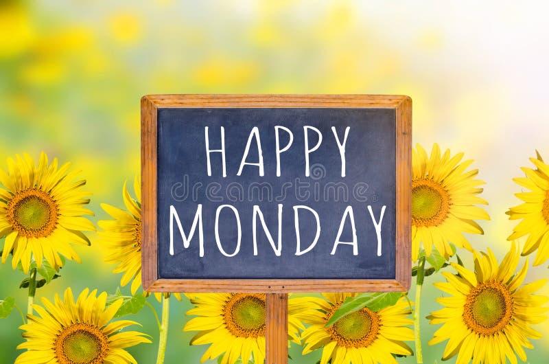 Happy Monday on blackboard. With sunflower background stock image