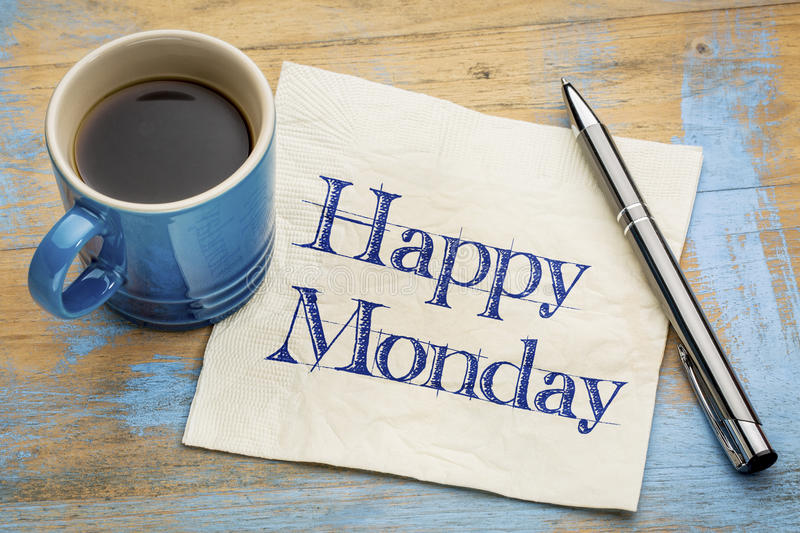Happy Monday napkin handwriting. Happy Monday - cheerful handwriting on a napkin with a cup of coffee stock photos