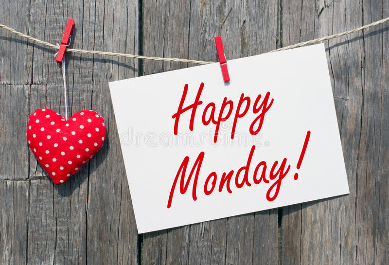 Happy Monday. White sign with text and red heart on wooden background stock image