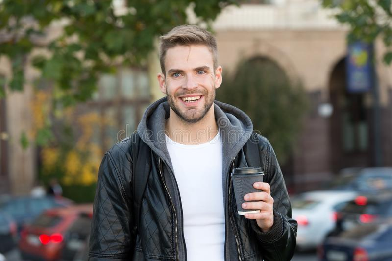 Happy morning. Hipster hold paper coffee cup. Coffee break. Drink it on go. Man smiling cheerful hipster hold coffee royalty free stock photo
