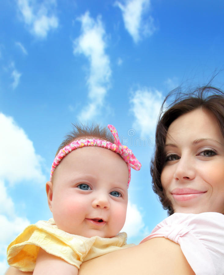 Happy mother with a baby stock photos
