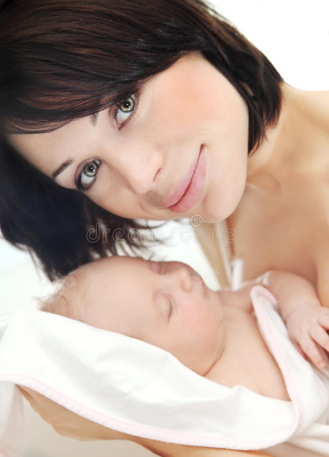 Happy mother with a baby royalty free stock photography
