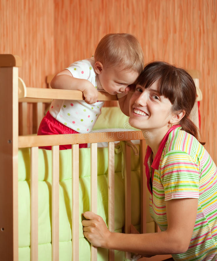 Download Happy mother with  baby stock image. Image of indoor - 26489419