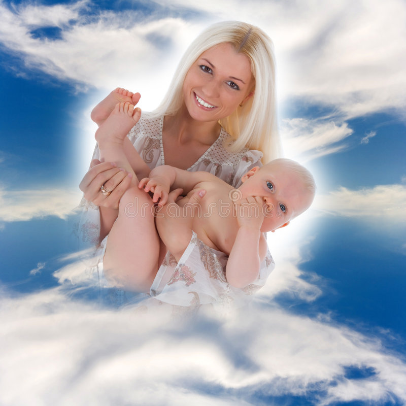 Happy mother with baby. Over sky stock photo