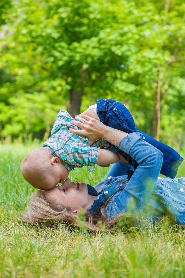 Happy mother and baby boy royalty free stock images