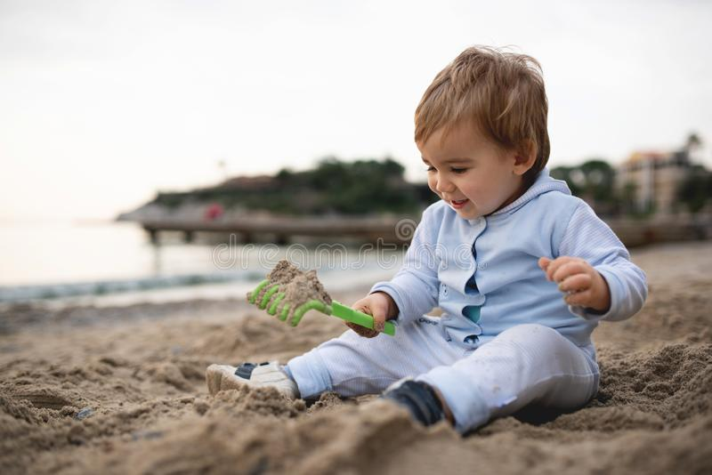Happy Baby Boy Playing At Seaside stock images