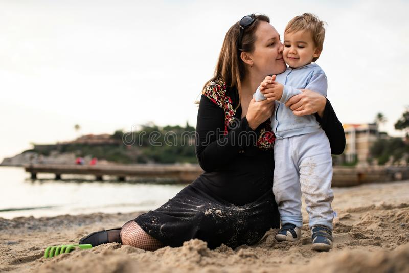 Happy Mother and Baby Boy Playing Together At Beach royalty free stock photos