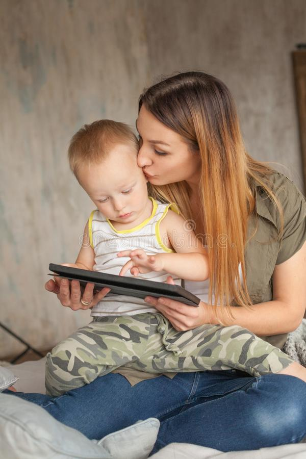 Happy Mother with Baby Boy and Tablet pc computer learning royalty free stock photos