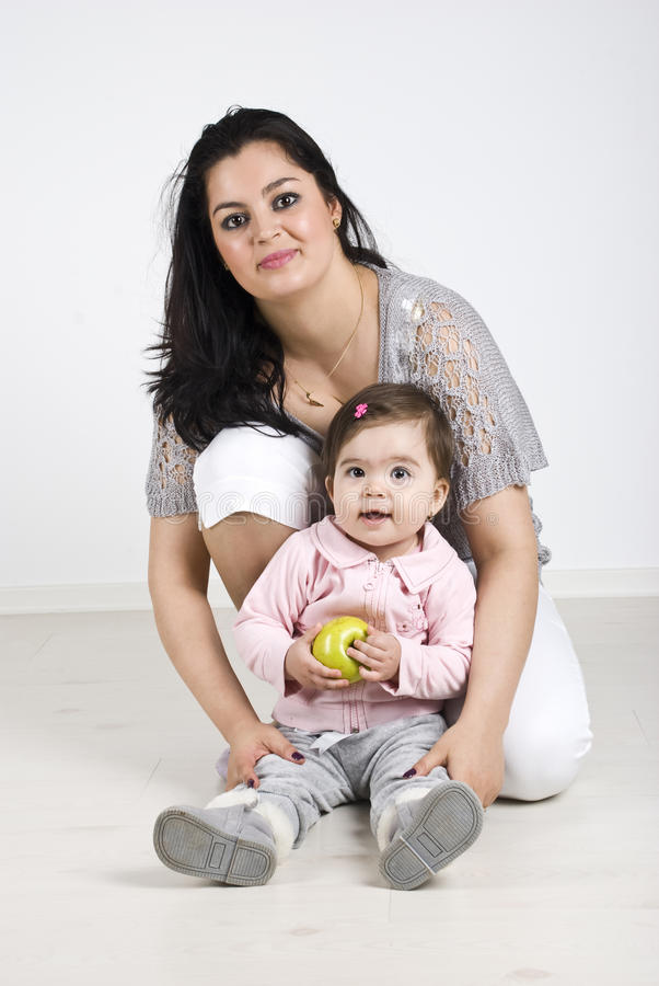 Download Happy Mother With Baby Girl Holding An Apple Stock Image - Image: 14064623