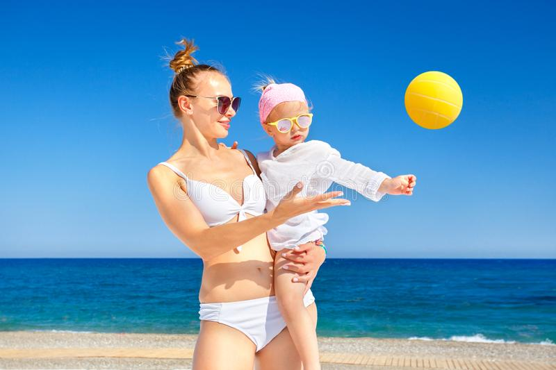 Happy Mother And Baby Girl Playing With Beach Ball. royalty free stock image