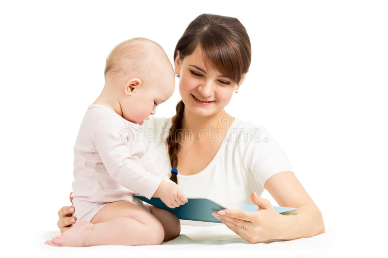 Happy mother and baby reading a book together stock photos