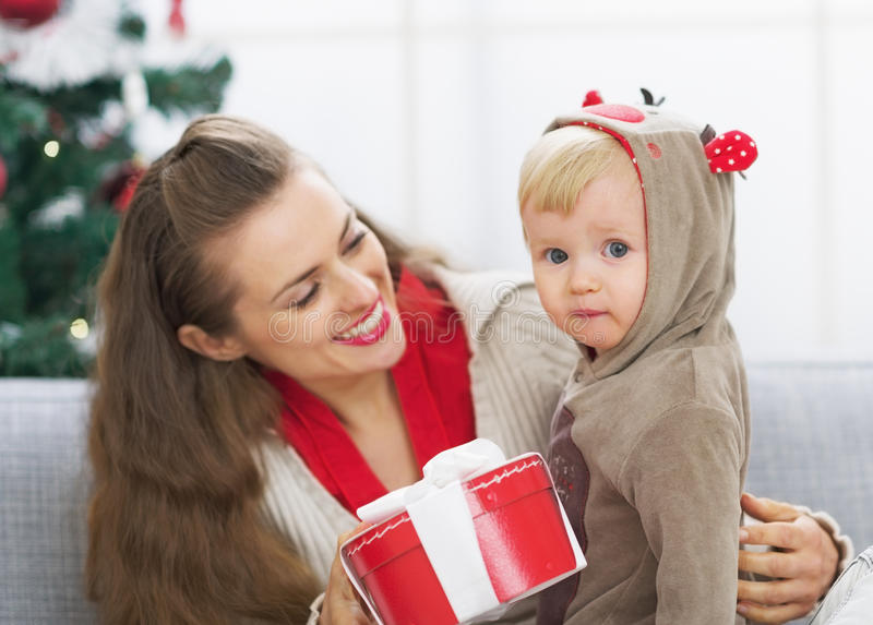 Happy mother and baby spending christmas time together royalty free stock photography