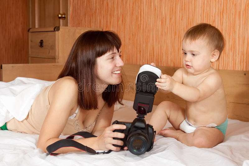 Happy mother with baby takes photo stock images