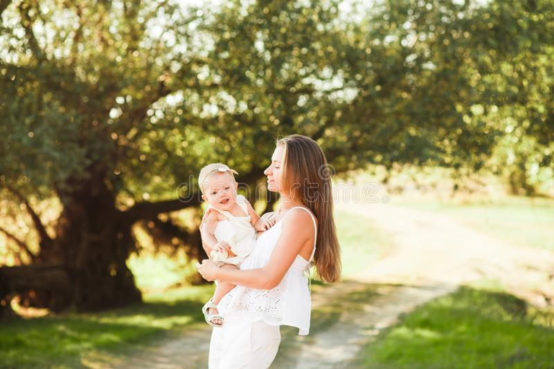 Happy mother and baby walking in city royalty free stock photos