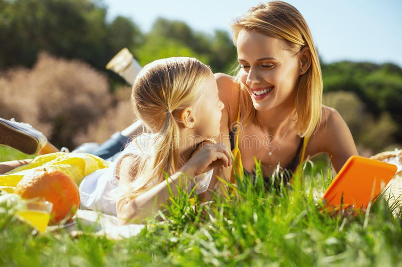 Inspired mother and daughter spending time together royalty free stock image