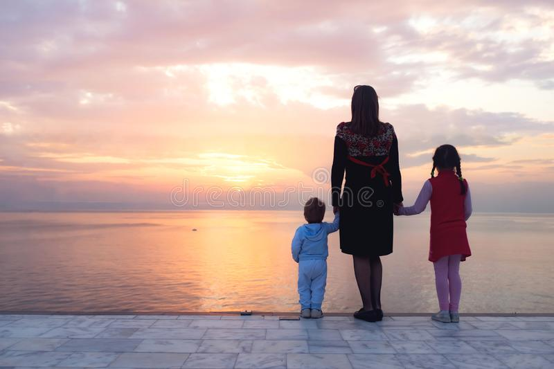 Happy Mother, Child Daughter and Toddler Son Watching Sunset stock photos
