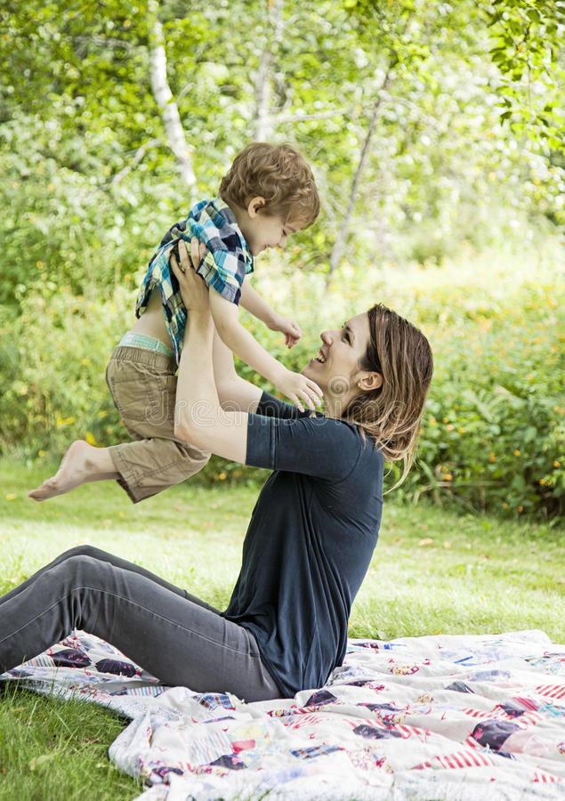 Happy mother and child. Mother and son playing and laughing outdoors stock photos