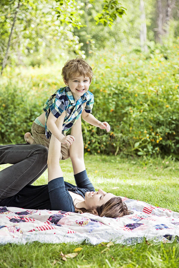 Happy mother and child. Mother and son playing and laughing outdoors royalty free stock images