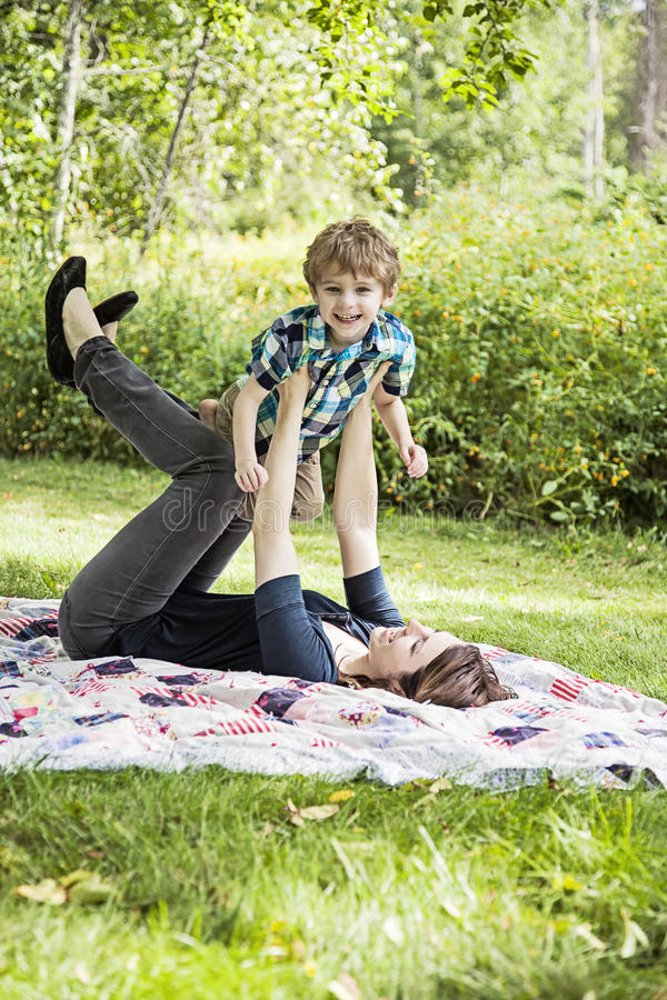 Happy mother and child. Mother and son playing and laughing outdoors stock photography