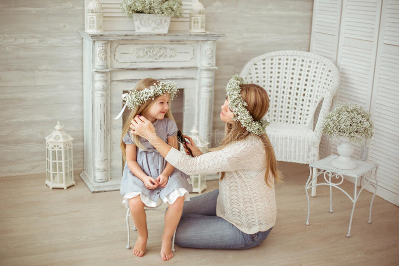 A happy mother is combing her daughter's hair royalty free stock photos