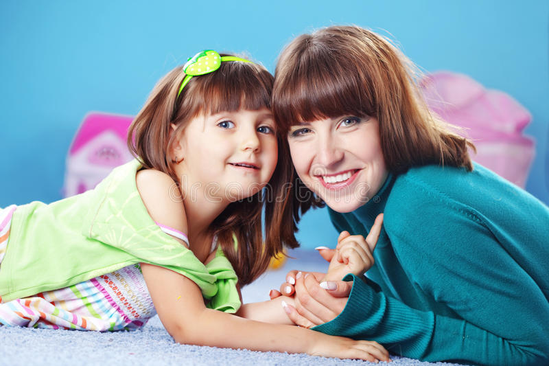 Happy mother with daughter stock images