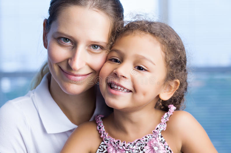 Happy mother and daughter. Lovely happy family of two looking at camera royalty free stock photography