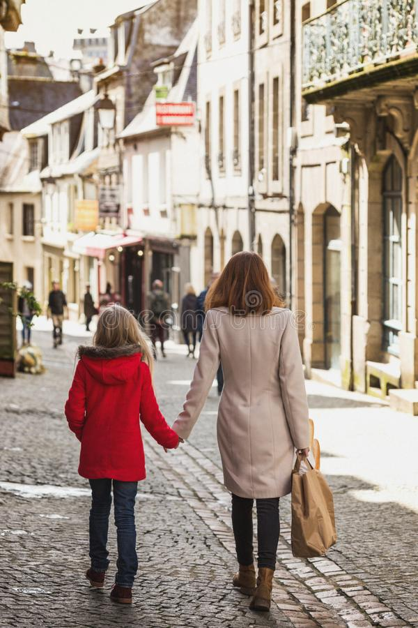 Happy mother and daughter at the city stock image