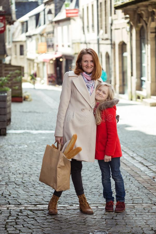 Happy mother and daughter at the city royalty free stock image