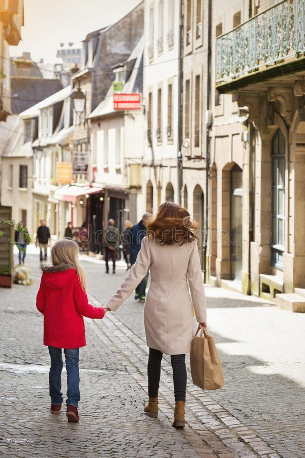 Happy mother and daughter at the city stock photography