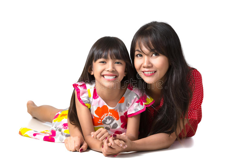 Download Happy Mother And Daughter Laying On The Floor Stock Image - Image: 33447423
