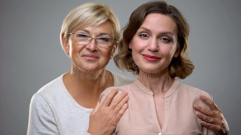 Happy mother and daughter looking in camera, tender female relations, connection royalty free stock photography