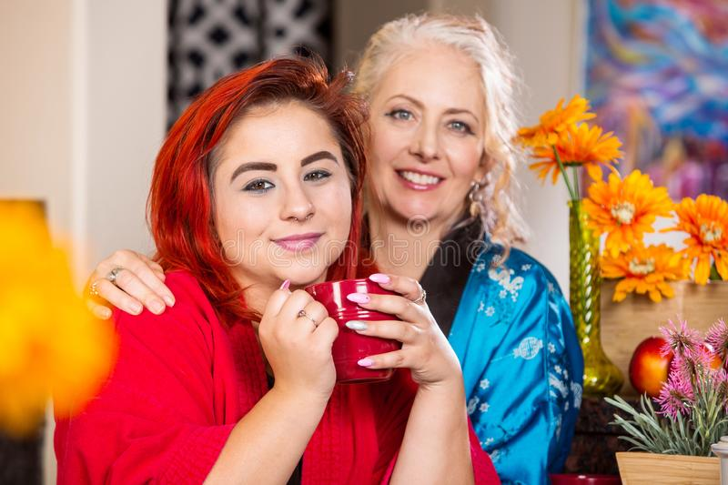 Happy Mother and Daughter with coffee mug stock image