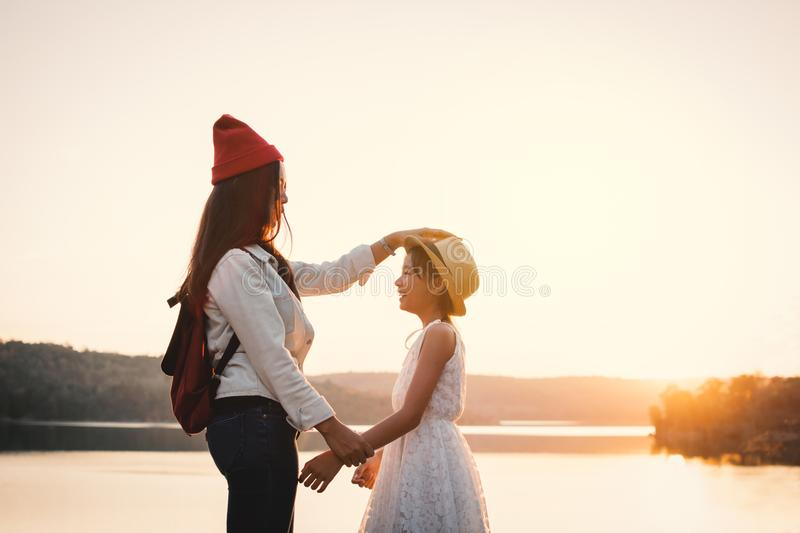 Happy mother and daughter in nature during sunset stock photo