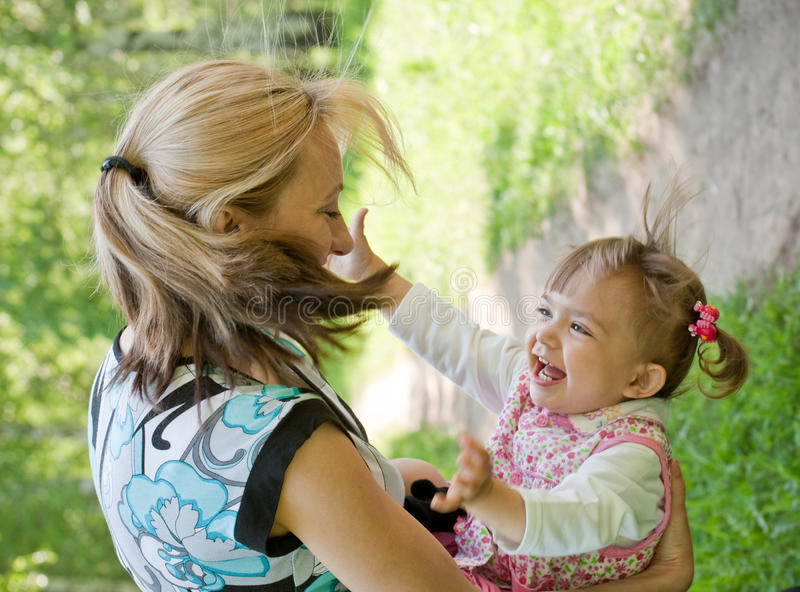 Happy mother and daughter playing outdoor, Summer stock image