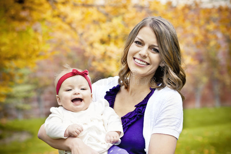 Happy Mother and Daughter Portrait. An adorable little girl smiling and laughing with her mother stock image