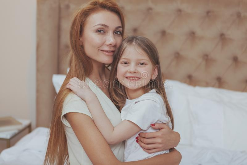 Happy mother and daughter resting at home together royalty free stock image