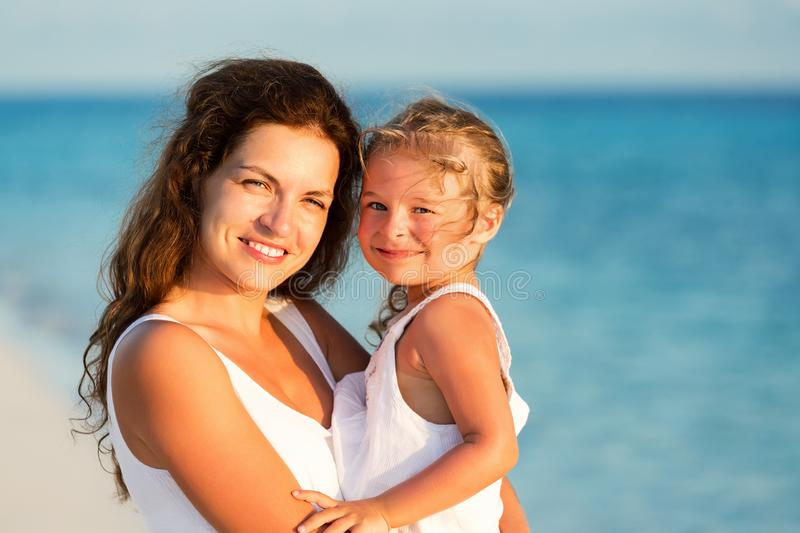 Happy mother and daughter at sea coast royalty free stock images