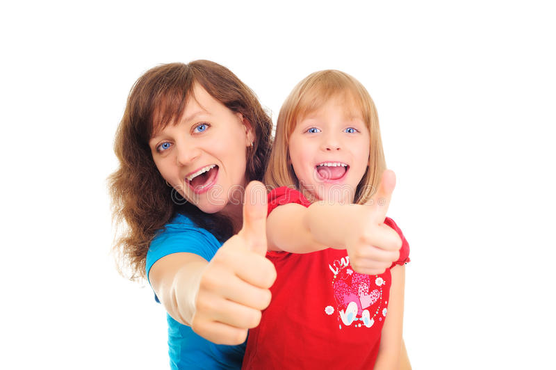 Happy mother and daughter showing okay sign stock photography
