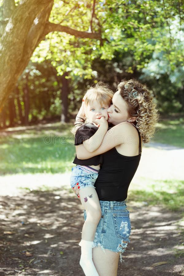 Happy mother with daughter similar look tender kiss stock image