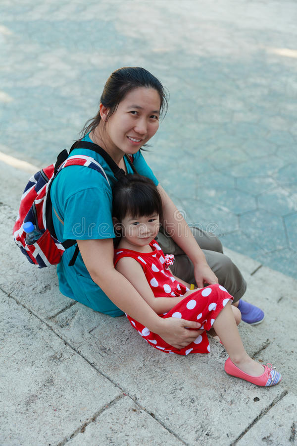 Happy mother and daughter smiling and relaxing outdoors, travel royalty free stock photography