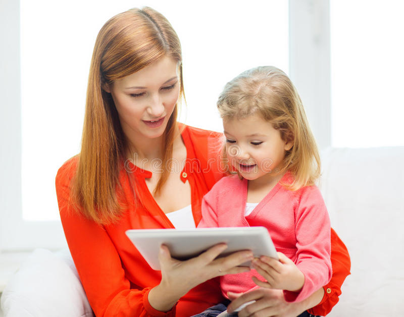 Download Happy Mother And Daughter With Tablet Pc Computer Stock Photo - Image: 38574748