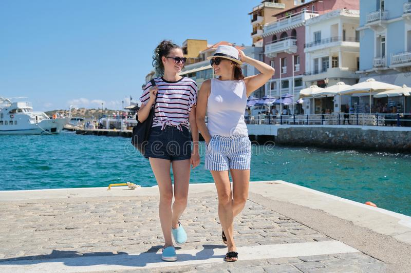 Happy mother and daughter teenager walking, summer sea vacation royalty free stock photos