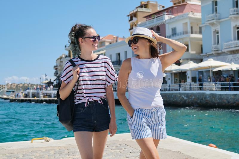 Happy mother and daughter teenager walking, summer sea vacation royalty free stock photo