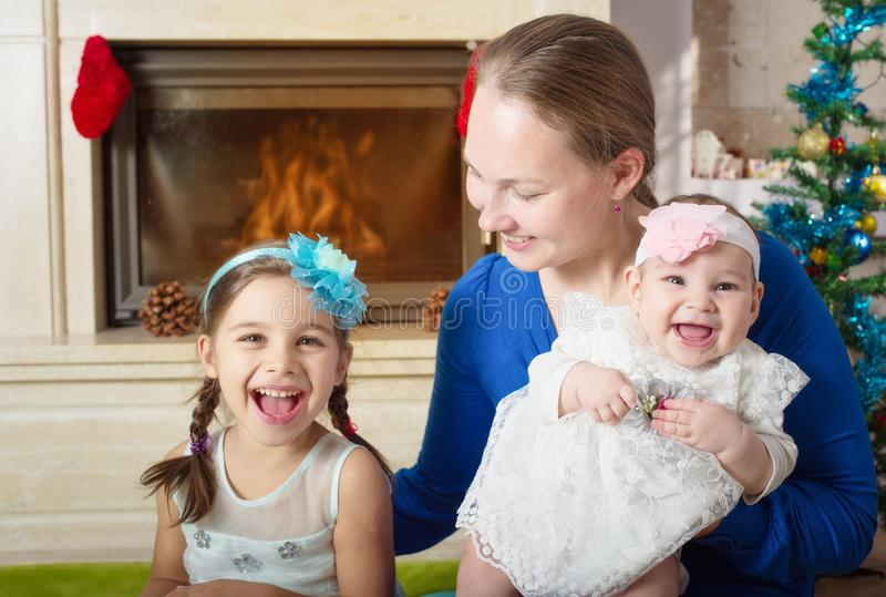 Happy Mother And Daughters In Christmas Evening stock photography