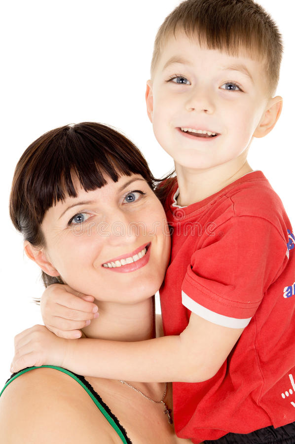 A happy mother embraces her child stock photo