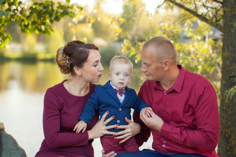 Happy mother, father and son in the park. Happiness in family life in summer day stock photography