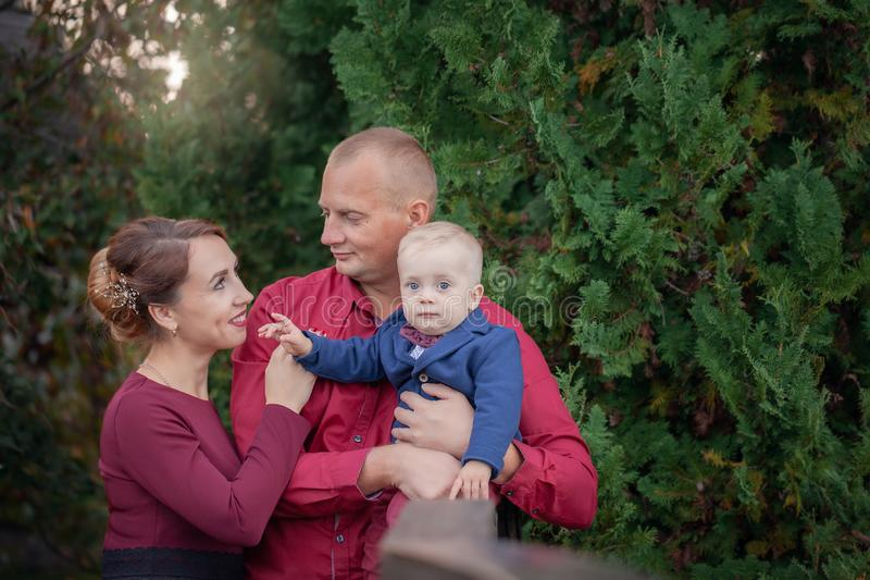 Happy mother, father and son in the park. Happiness in family life in summer day royalty free stock image