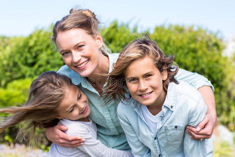 Happy mother with her children stock image