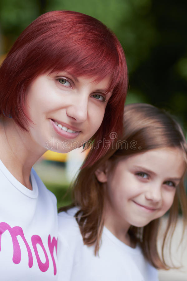 Happy mother and her daughters outdoors royalty free stock photo