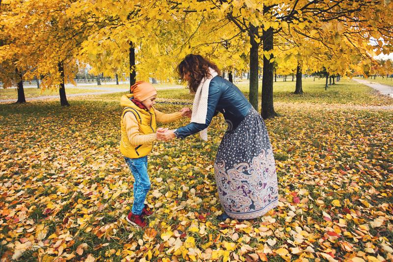 Happy mother and her son child boy playing outdoors stock photos